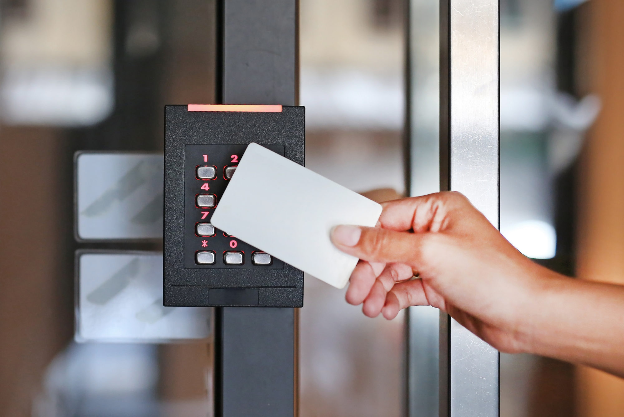 Door access control, young woman holding a key card to lock and unlock door, access control system, access control system installation, alarm system